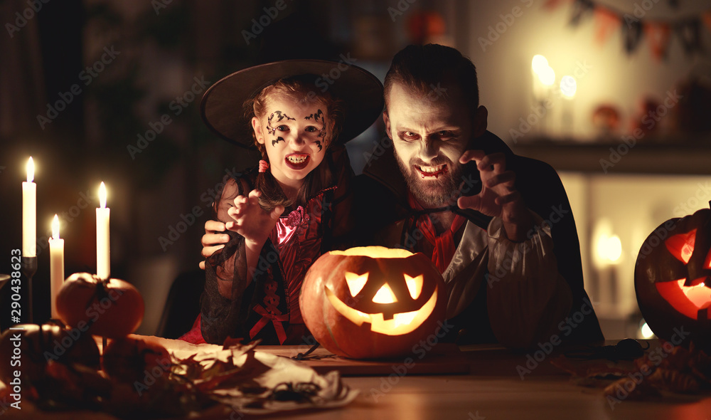 Fototapety, obrazy: happy family   father and child daughter in costumes and makeup on  Halloween