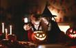 Leinwanddruck Bild - happy children in costumes of witch and vampire in a dark house in halloween.