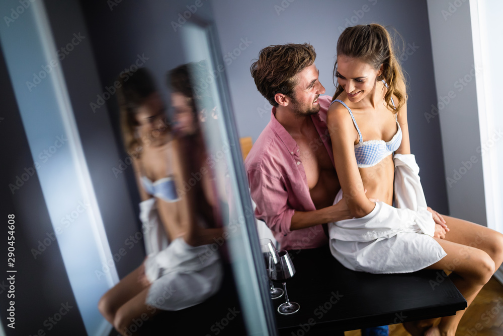 Fototapety, obrazy: Beautiful happy couple of young lovers are hugging indoors at home, with love and tenderness