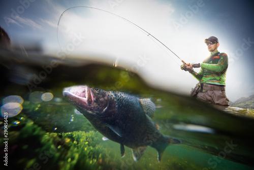 Valokuva Fishing. Fisherman and trout, underwater view.