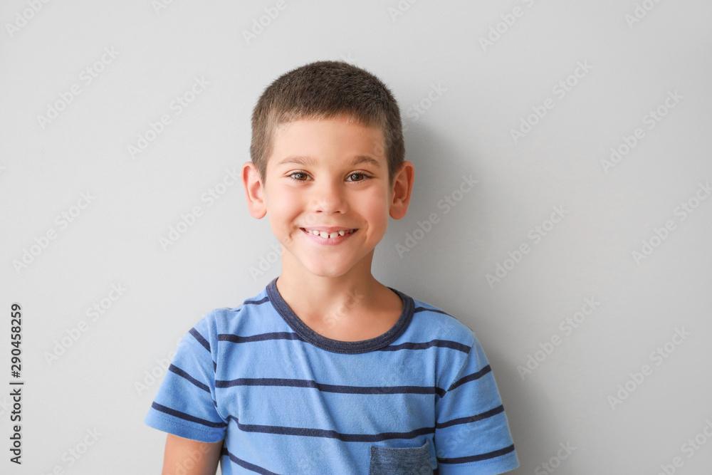 Fototapety, obrazy: Portrait of happy little boy on light background