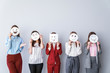 canvas print picture - Group of woman covering their faces with drawn emoticons against light background