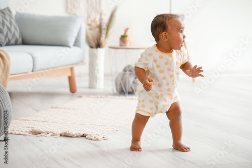 Cute little baby learning to walk at home Canvas Print