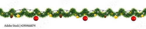 Fototapeta Christmas garland of mistletoe tinsel with festive light and decorations of gold