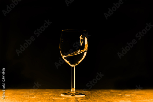In de dag Alcohol a glass of water stands on a bright background
