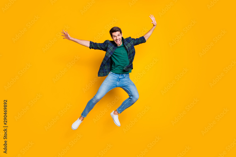 Fototapety, obrazy: Full size photo of satisfied excited enthusiastic man jump enjoying free time on holidays good-looking wear modern trendy outfit isolated over yellow color background