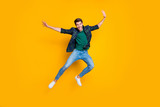 Full size photo of satisfied excited enthusiastic man jump enjoying free time on holidays good-looking wear modern trendy outfit isolated over yellow color background - 290469892