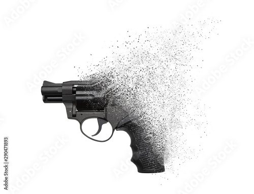 Fototapeta  A gun crumbling into particles in space isolate on a white background