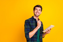 Photo Of Nice Guy With Organizer In Hands Making Notes Creating Startup Idea Wear Casual Checkered Shirt Isolated Yellow Color Background