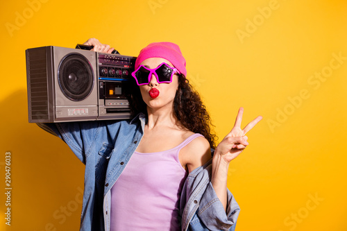 Photo sur Aluminium Magasin de musique Photo of flirty lady with tape recorder on shoulder showing v-sign sending air kiss wear casual trendy clothes isolated yellow color background