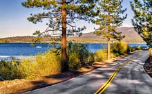 View Of California Highway Alongside Big Bear Lake Coastline.