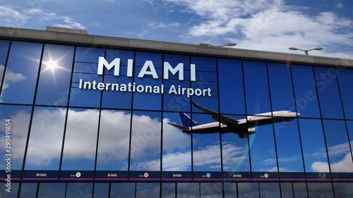 Photo Airplane landing at Miami, Florida mirrored in terminal