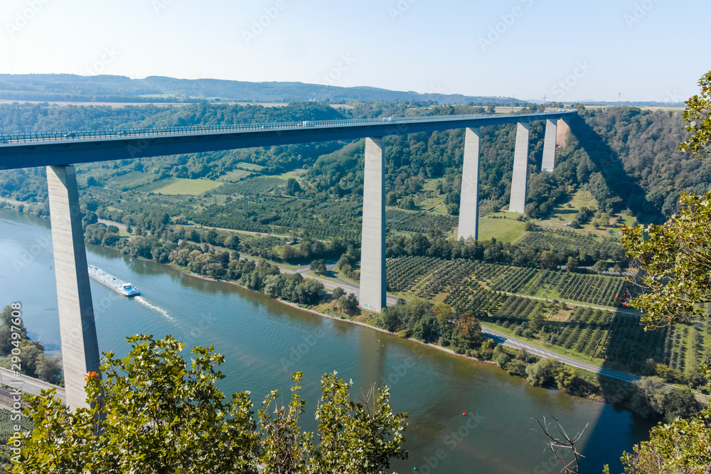 Fototapety, obrazy: View on high freeway viaduct bridge across Mosel river valley and terraced vineyards, road network and transportation is Germany