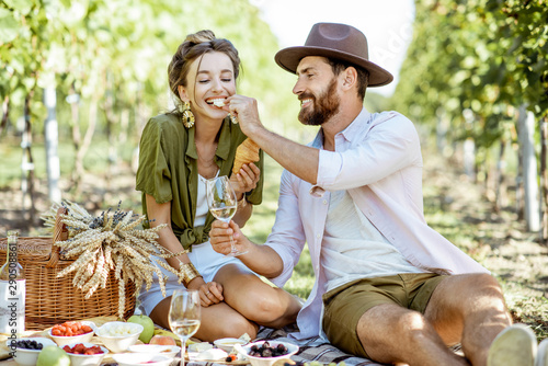 Beautiful couple having romantic breakfast with lots of tasty food and wine, sit Canvas