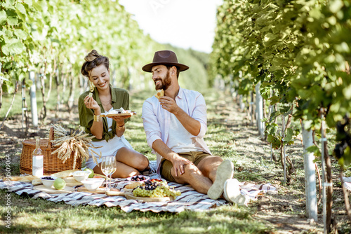 Beautiful couple having romantic breakfast with lots of tasty food and wine, sit Fotobehang