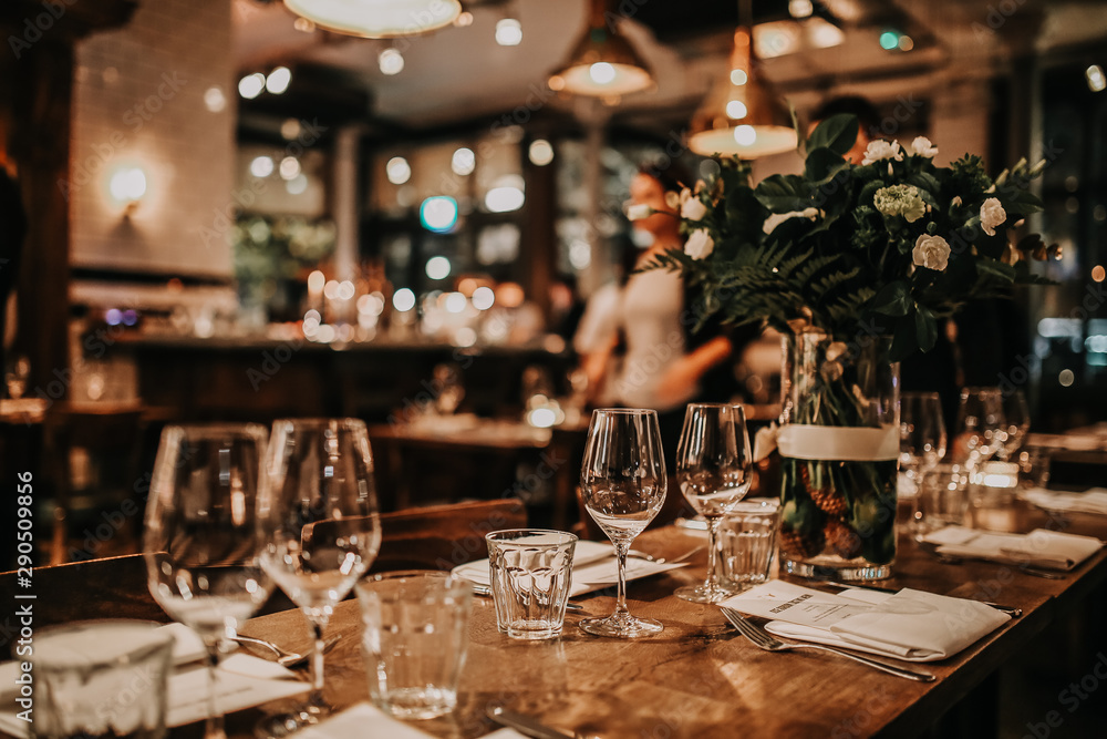 Fototapety, obrazy: Elegant table set up for a romantic dinner. Concept of catering, hospitality and private dining. Selective focus on the glassware.