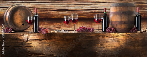 Acrylic Prints Wine still life with red wine with barrel on old wood