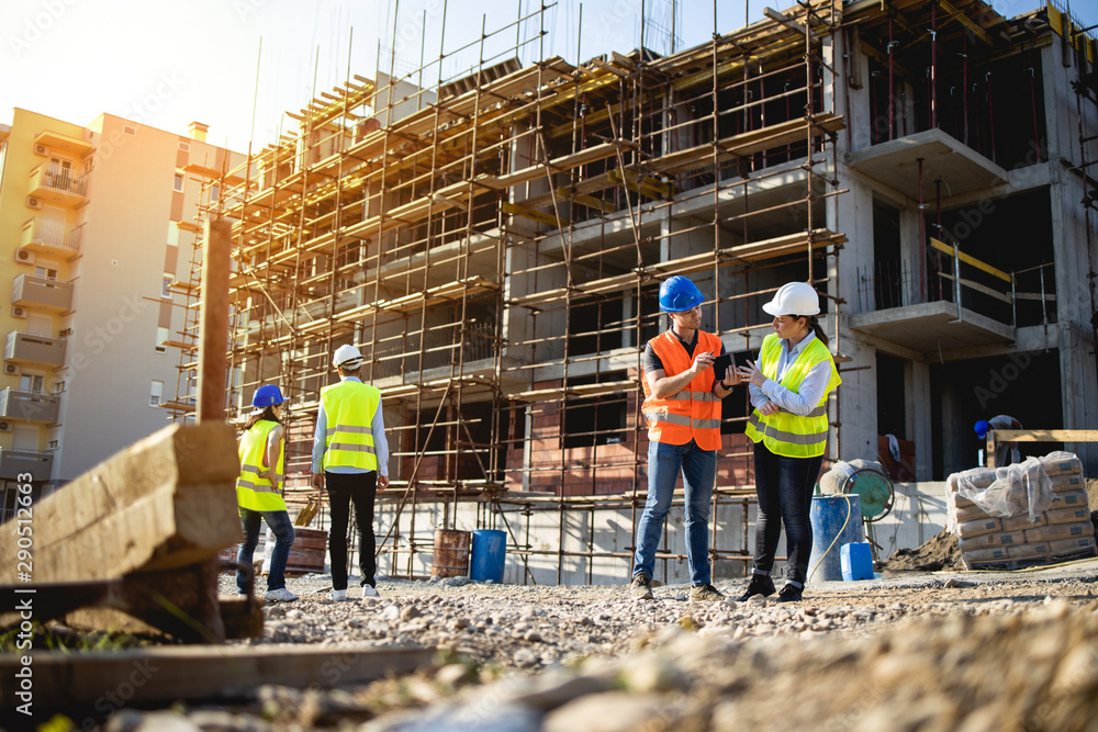 Fototapety, obrazy: Four construction workers having meeting,stock photo