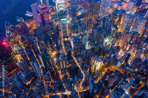 Aerial top view of Hong Kong Downtown, Republic of China. Financial district and business centers in technology smart city in Asia. Top view of skyscraper and high-rise modern buildings at night.
