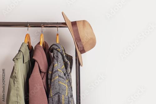 Fotografie, Tablou  Feminine autumn or winter outwear on the hangers
