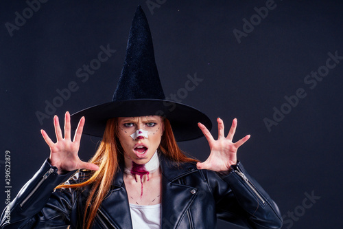 Fotografia, Obraz redhaired ginger woman witch black hat and in leather jacket screaming and scari