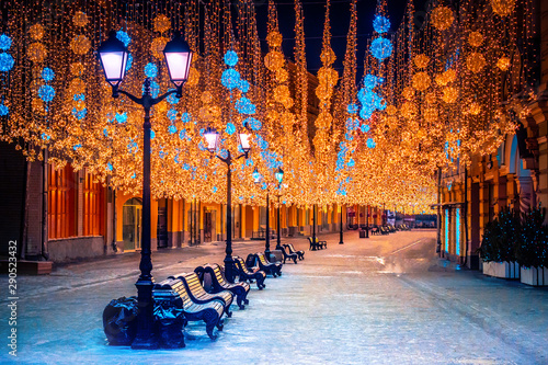 Obraz Russia. Christmas Moscow. Night lights on Moscow. Illumination in winter Moscow. Garlands in the cities of Russia. Traveling in Russian cities. Tourism in Russia in the winter. Snow. Public spaces - fototapety do salonu