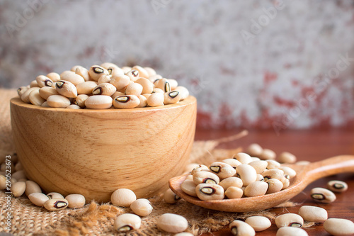 Black eyed beans in wooden bowl on rustic table. Fototapeta