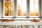 White wooden table and autumn leaves  - 290525865