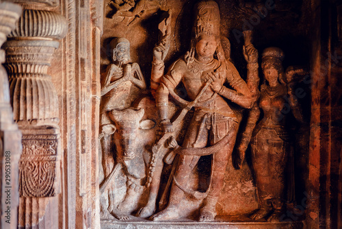 Naklejki historyczne sculptures-of-shiva-lord-inside-of-6th-century-hindu-temple-in-india-architecture-with-carved-walls-in-badami