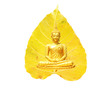Leinwanddruck Bild Buddha statue, meditation and a bright yellow Bodhi leaf as background Visakha Bucha Day Concept.