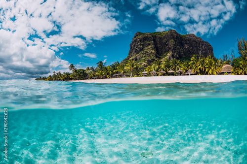 Tropical crystal ocean with Le Morne mountain and luxury beach in Mauritius. Split view.