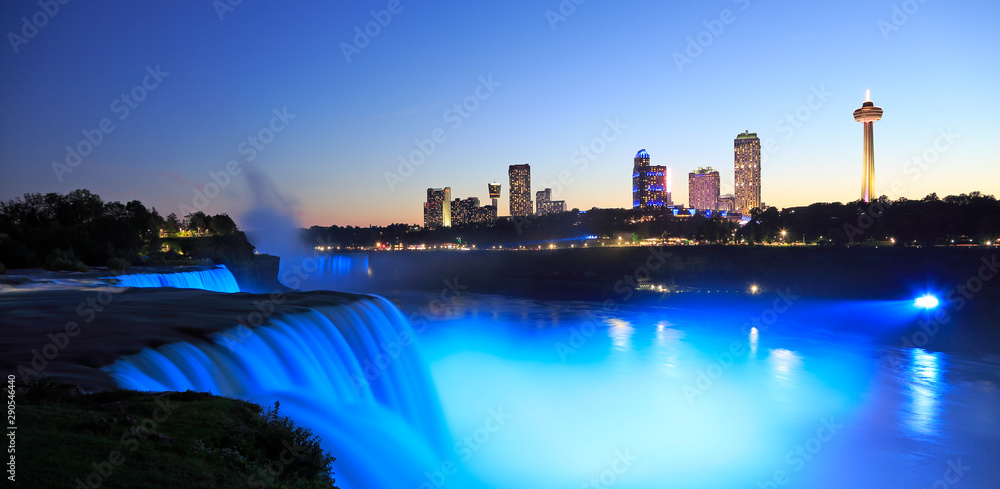Fototapety, obrazy: Niagara Falls at dusk including the skyline of the Canadian city of the background