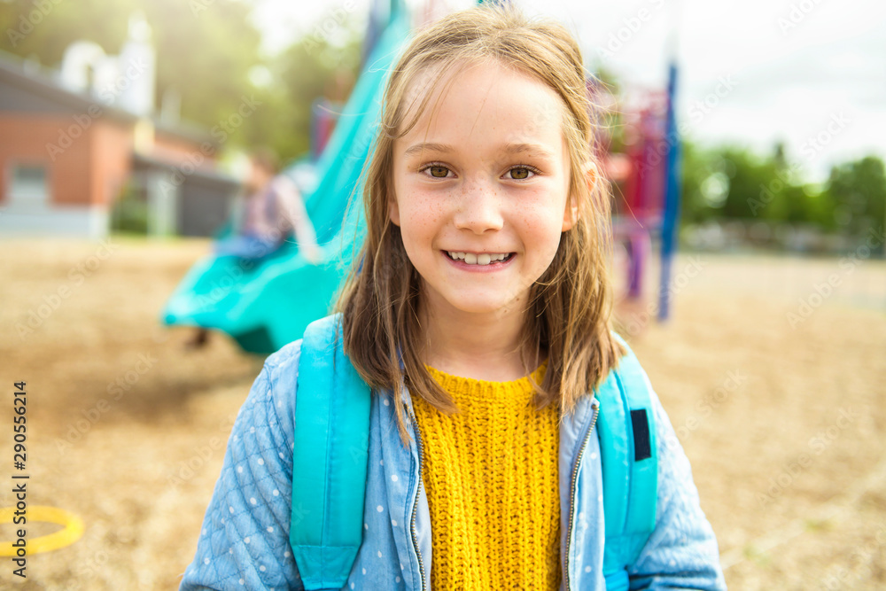 Fototapeta the girl on the playground on the school day