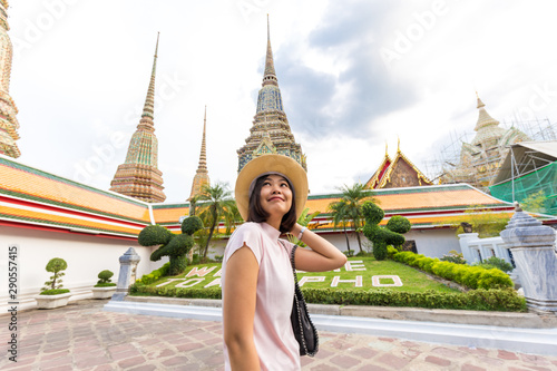 Asian tourist women with sun protect hat travel in Wat Pho Temple