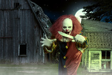 An Eerie Clown With A Knife In Hand In Front Of A Scary Scene