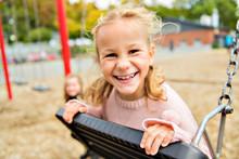 The Girl On The Playground Swi...