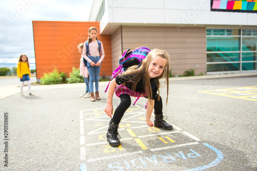 Fotografija A Hopscotch on the schoolyard with friends play together