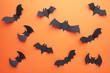 Leinwanddruck Bild - Halloween paper bats on orange background. Halloween concept