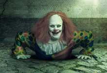 A Grin Killer Clown Rising From The Sewer