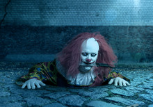 A Scary Clown With A Knife In The Mouth Rising From The Sewer
