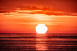 canvas print picture - Beautiful red and orange sunset over the sea. The sun goes down over the sea.