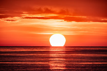 Beautiful Red And Orange Sunset Over The Sea. The Sun Goes Down Over The Sea.