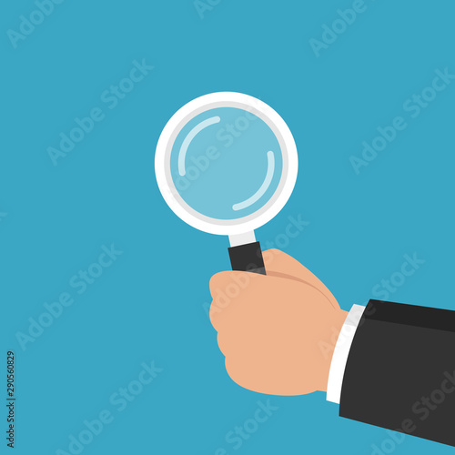 Hand holding a magnifying glass. Audit, analysis, inspection concepts. Flat cartoon style. Vector illustration.
