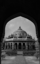 A Black And White Of A Dome Shaped Building Taken From Inside A Pathwa