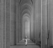 A Woman Is Walking Down The Long Archways Of The Cathedral