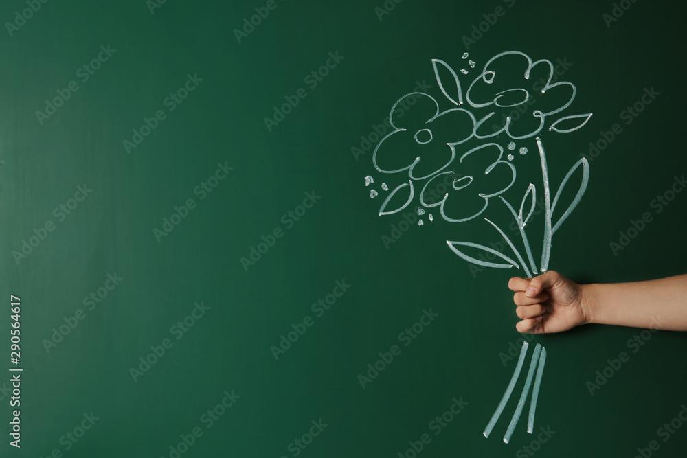 Fototapeta Closeup view of woman with drawn flowers on green chalkboard, space for text. Teacher's day - obraz na płótnie