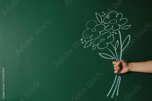 Obraz Closeup view of woman with drawn flowers on green chalkboard, space for text. Teacher's day - fototapety do salonu