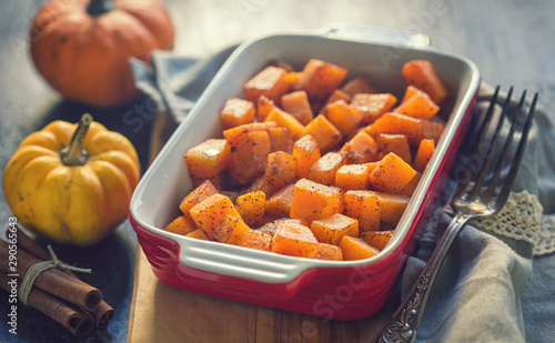 Fotomural  Pumpkin with honey and cinnamon baked in oven