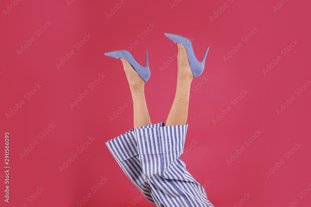 Fototapeta Woman in elegant shoes on crimson background