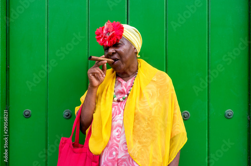 Old Cuban lady smoking a large cigar in La Havana, Cuba Wallpaper Mural